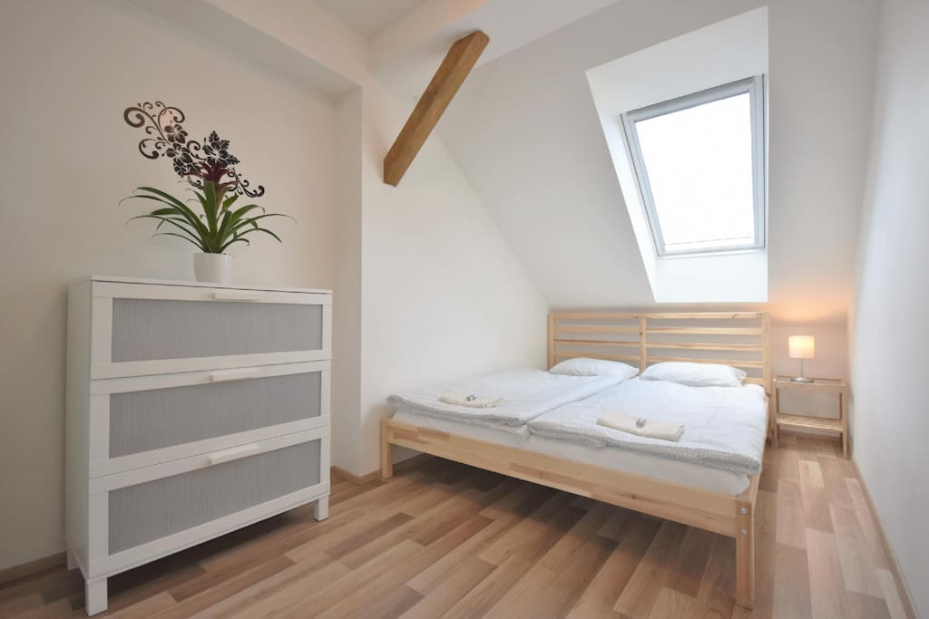 A spacious bedroom with a large double bed. Excellent mattresses will guarantee you a quit and quality sleep.