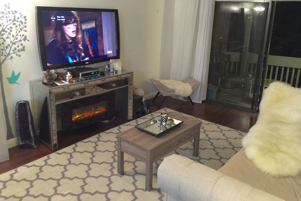 60 inch Flat screen, remote fireplace, bose system, roku and free movie streaming device!
