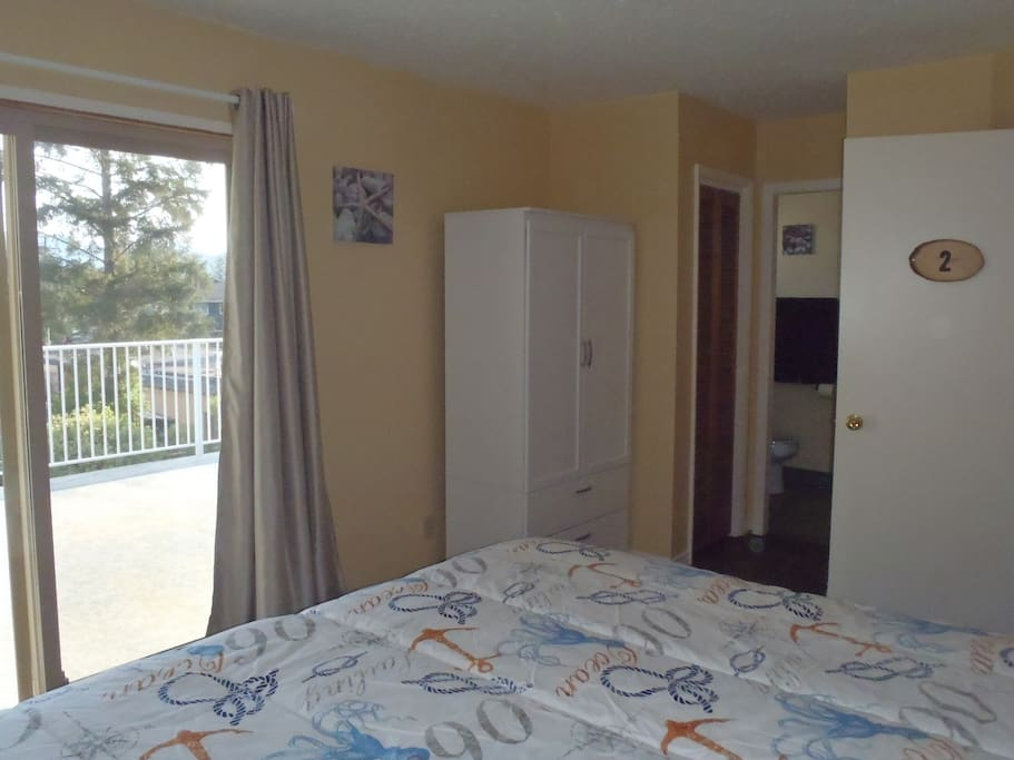 Deluxe Room-new armoire, curtains, bedding and beach decor.