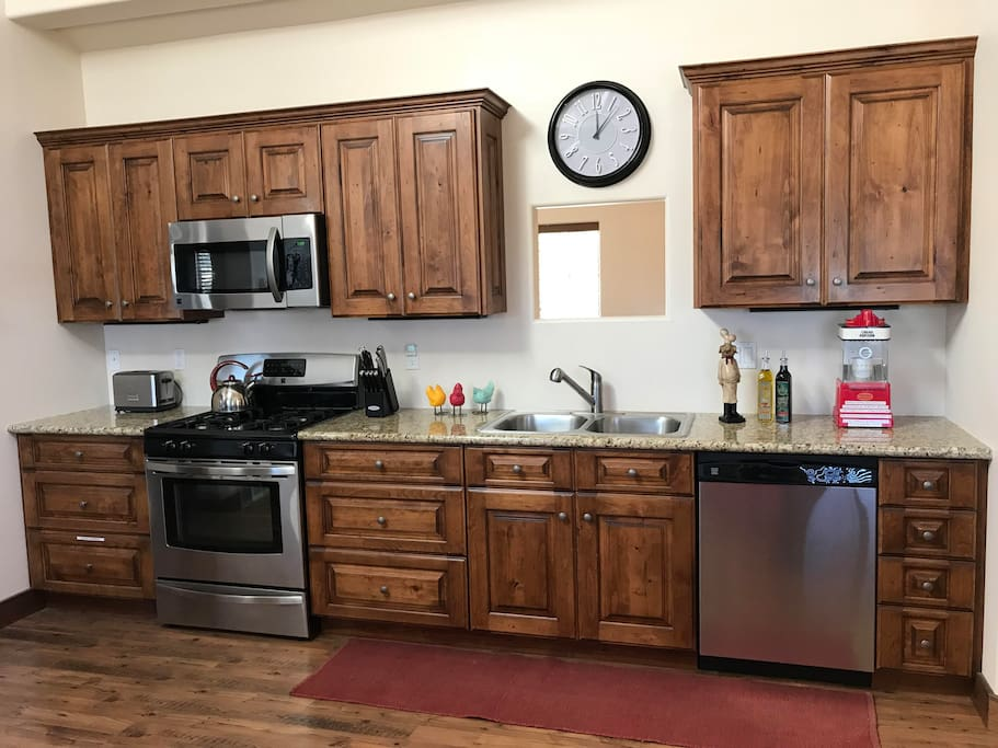 Fully stocked kitchen with dishwasher, gas stove and oven. Small appliances include toaster, rice cooker, crock pot and popcorn machine. We offer a convenient breakfast... pancakes, toaster pastries, oatmeal, cereal and breakfast drinks.