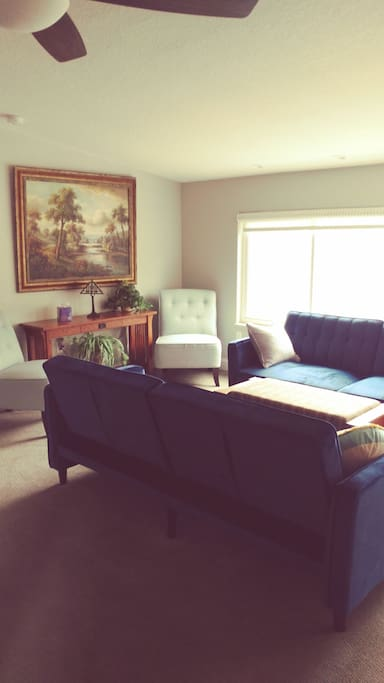 Comfortable and spacious living room, with two convertable sofas, into full size beds.