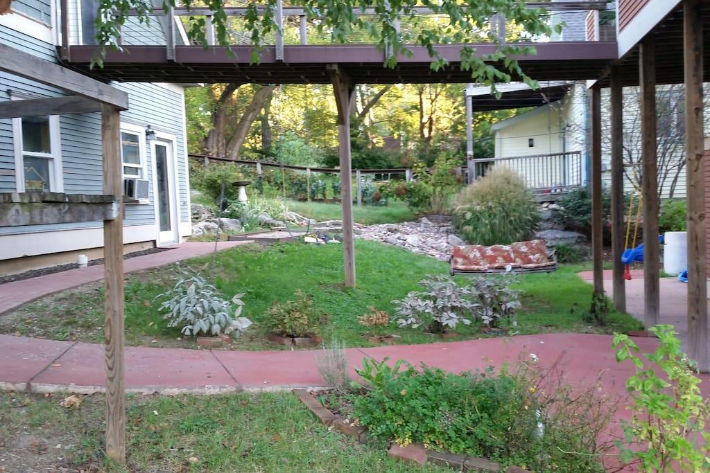 Play area. One swing, sandbox, porch swing.