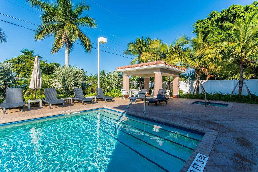 Take a dip in the shared swimming pool surrounded by tropical landscaping.