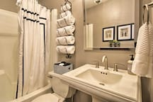 Get ready for a night on the town in the full bathroom.
