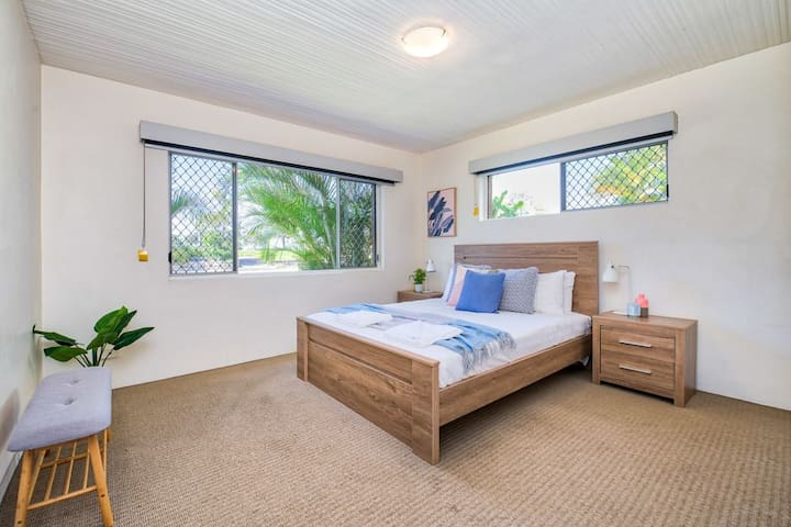 Main bedroom with built in wardrobes and split  air conditioner