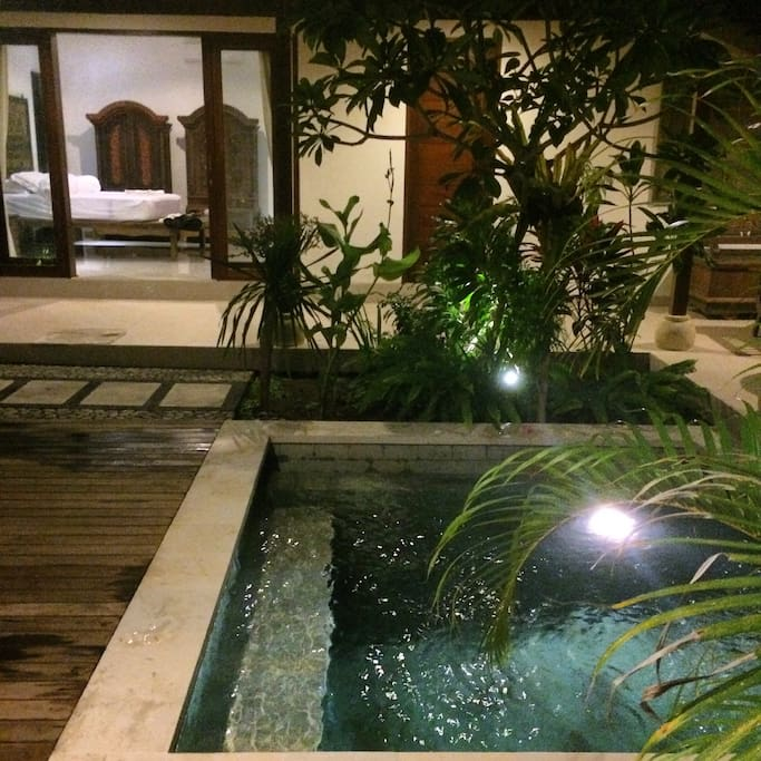 bedroom suite #1 with pool at night