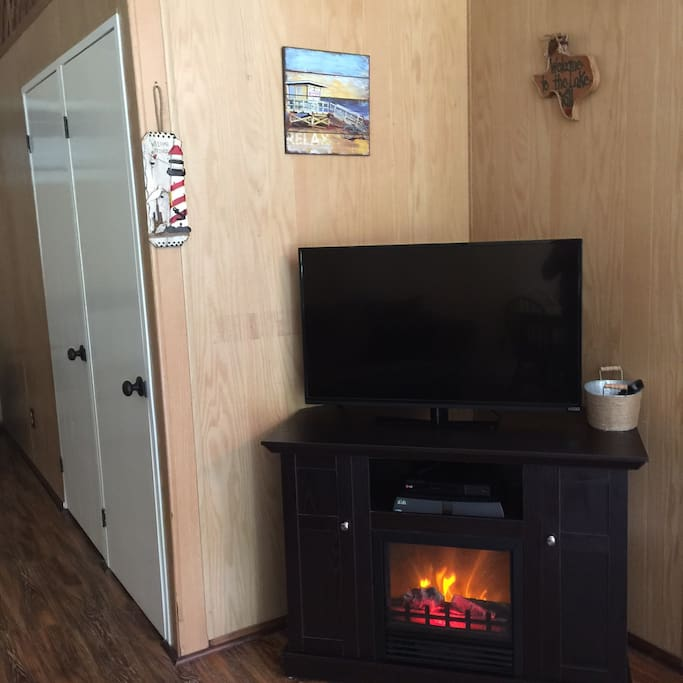 Electric fireplace, TV with DISH and DVD