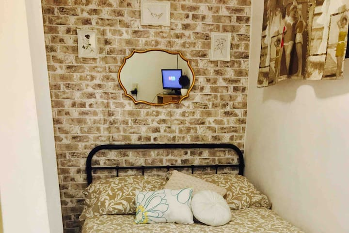 Small private bedroom. with TV, local channels.