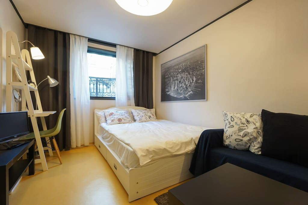 Full view of the bedroom where 3 people can sleep (queen size bed for 2 + sofa bed for 1)
