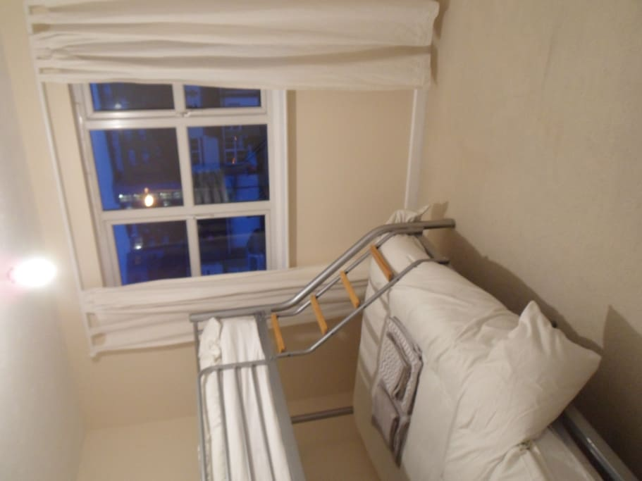 Lovely double room with a double bunk bed at bottom and and a single bed at the top.