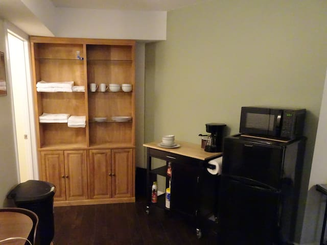 While the space does not have a full kitchen, it does have kitchenette area with a half-sized fridge/freezer, a microwave, coffee maker, and dishes.