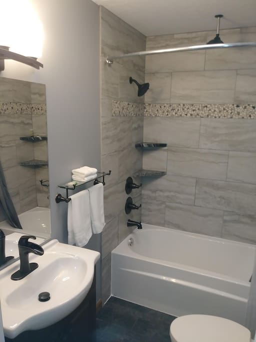 Bathroom with heated floors, bluetooth speaker, duel shower heads controlled independently and custom tile and granite throughout