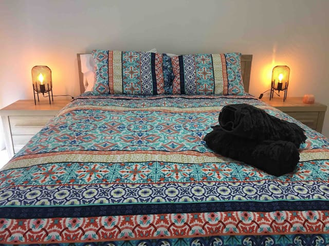 Bedroom 2 has a super comfortable solid wood queen bed, with bedside tables, lamps and power outlets for phone charging. Large robe with hangers provided.