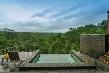 The infinity pool with wooden deck