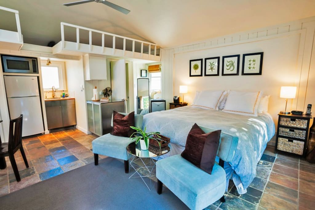 Kitchenette has microwave and refrigerator, full bath, tile floors and contemporary furnishings.