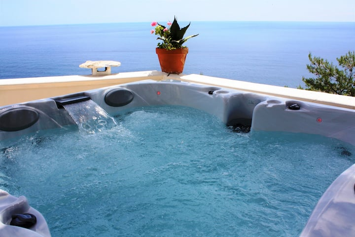 Large villa with outdoor jacuzzi over the sea