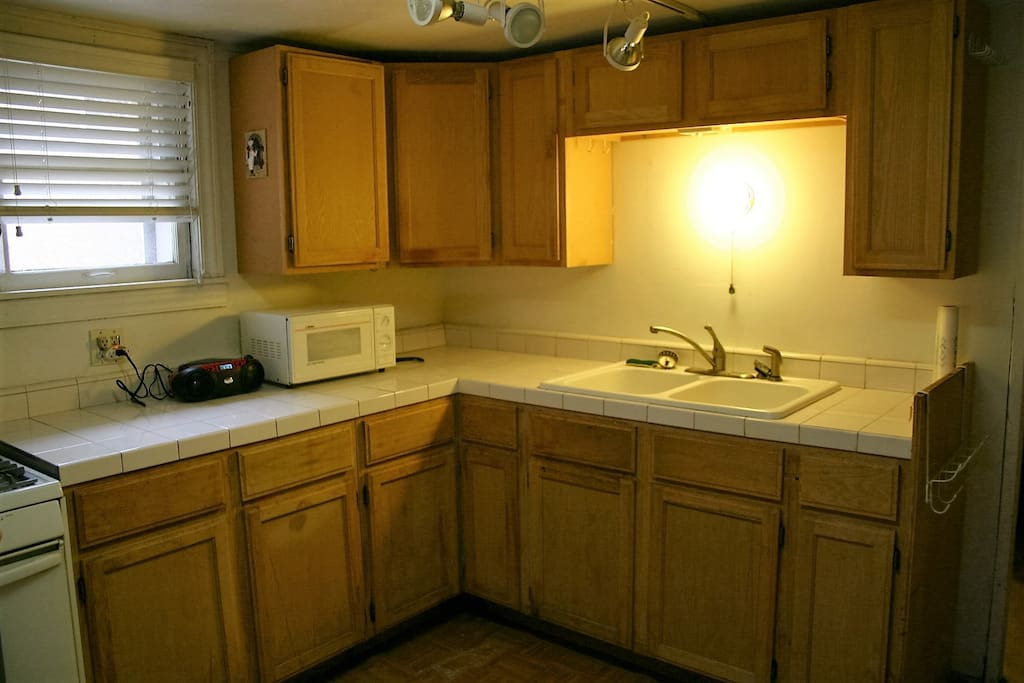 ceramic tile Counter tops, wood cabinets