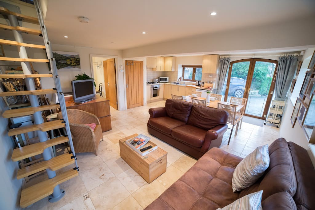 The living room and kitchen with under floor heating from an environmentally friendly air source heat pump.