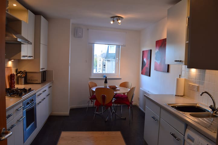 Spacious West End Apartment with Private Parking