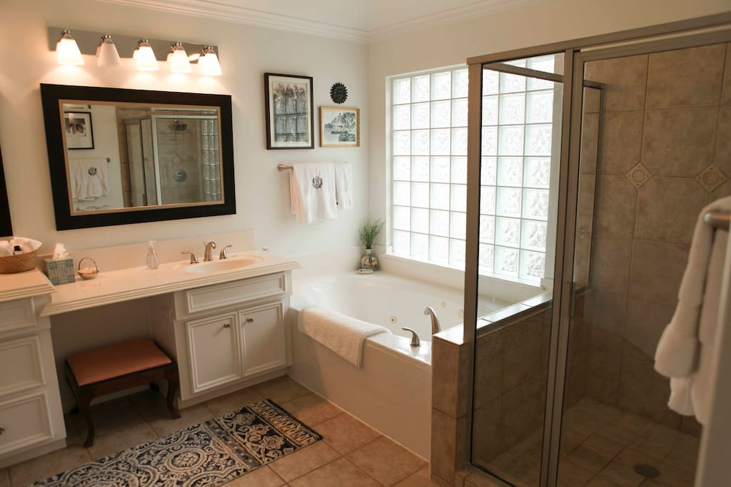 huge bathroom with double sinks, spa tub and shower