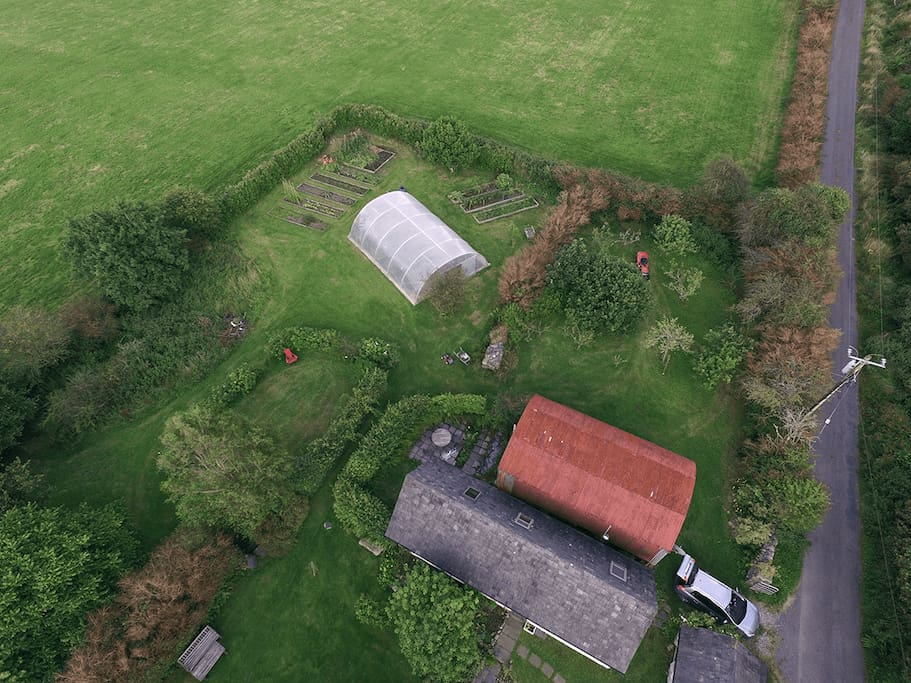 The cottage, the red barn, after which our publishing business is named, and the garden from the air. You can also see where the car parking spaces is! Photo courtesy of Lara Fritz.