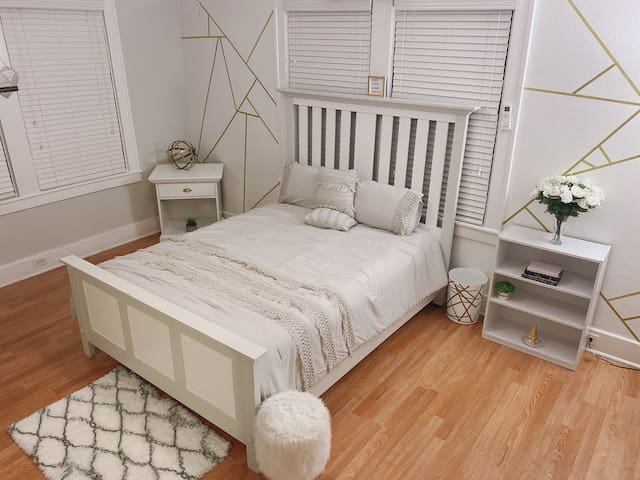 Studio/ Bed Area. There's a door that separates a small room. Television is provided in both rooms.