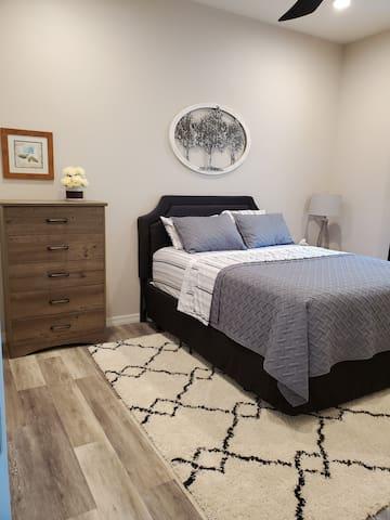 Comfortable queen size bed, 5 drawer dresser, closet.