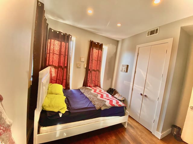 Comfy room, wit huge windows and a queen size bed