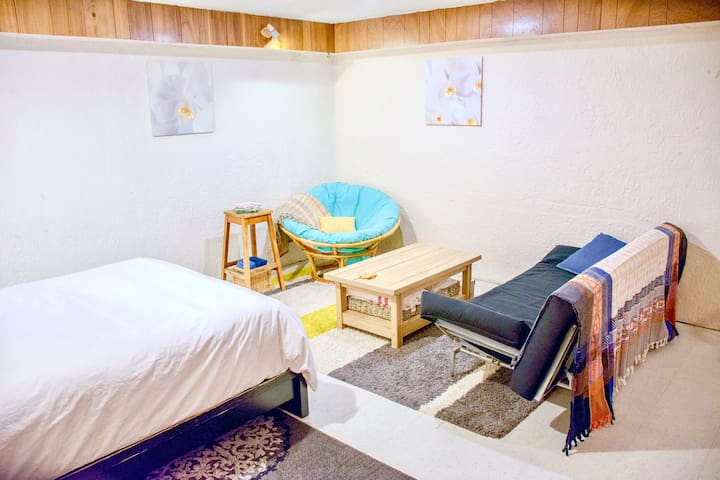 Calm refuge suite in central, treed community