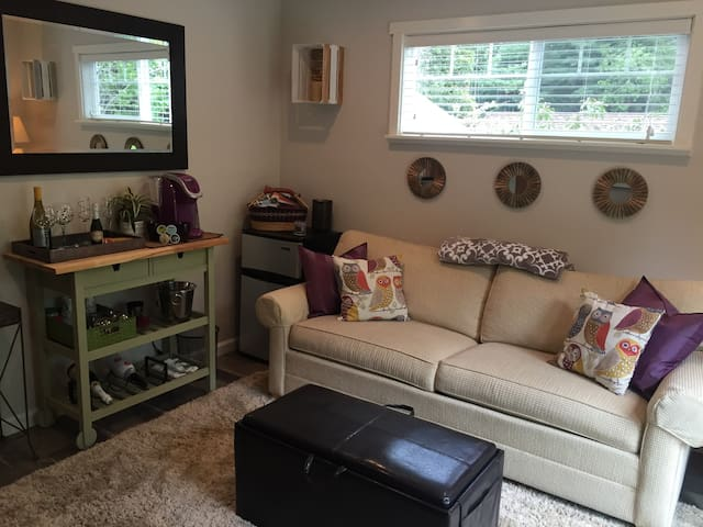 Another view of living room with mini fridge and coffee maker
