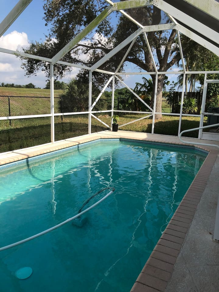 beautiful pool with private back and peaceful view