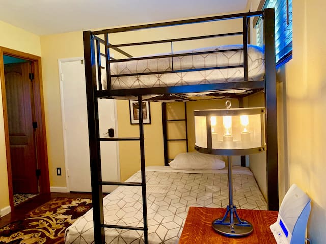 Bunks with both beds ready for guests. Bottom bunk is a Full and top is a Twin Bed.