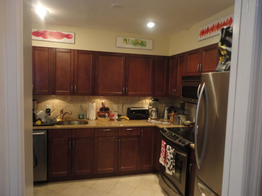 Updated kitchen with stainless appliances and granite countertops