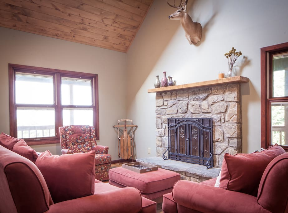Spacious and cozy great room with large stone fireplace