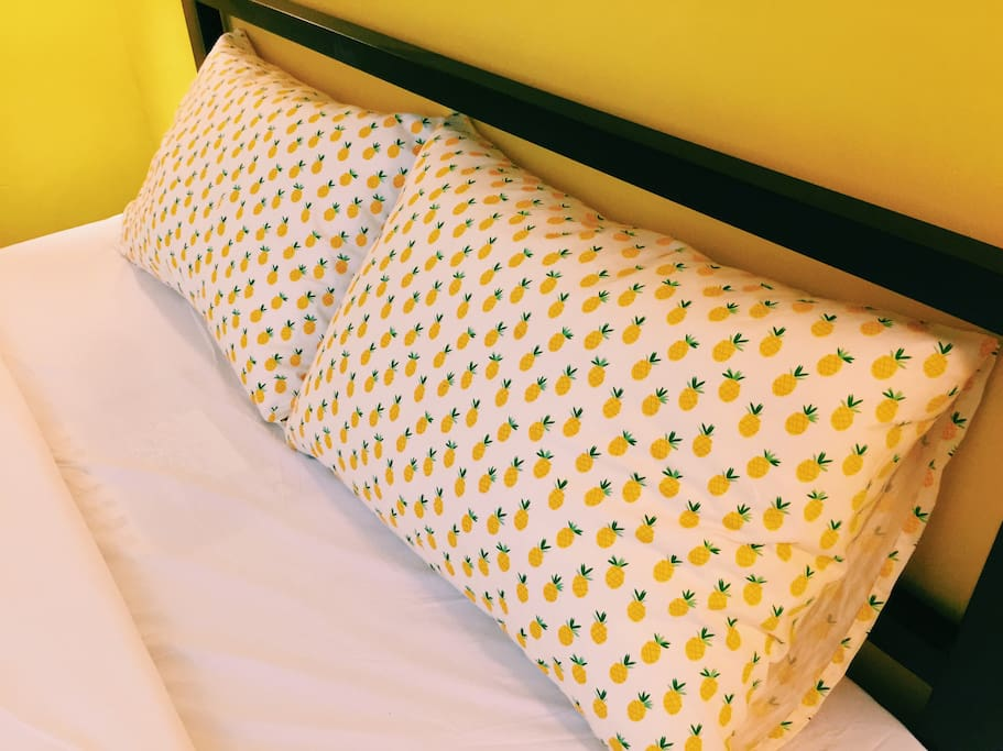 "Our fluffy pillow with signature ""Pineapple"" cases"