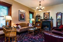 Guests are welcomed to the parlor for watching TV, reading, relaxing, meeting their guests, or enjoying a glass of wine. During the cooler months, we may light the fireplace. Original details add to the character of this comfortable space.