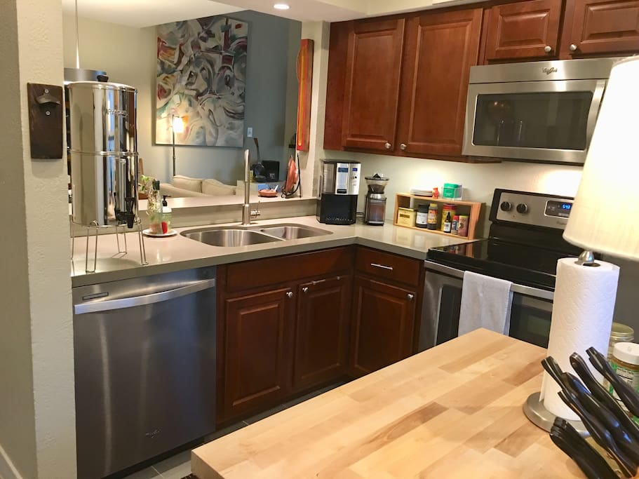 Complete full size kitchen boasting Stainless Appliances, quartz countertops and everything you need to prepare a meal. Complimentary FILTERED DRINKING WATER also provided.