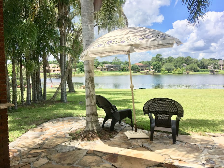 Outdoor patio area with barbecue and view of Lake Markham