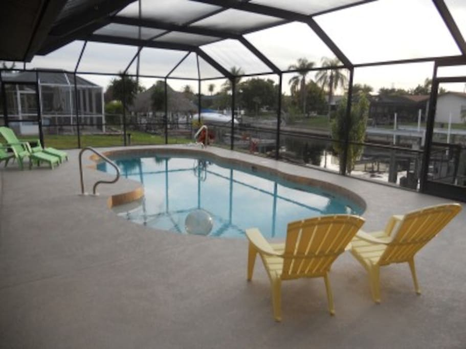 Large pool area inside lanai with grill.