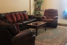 Italian leather sofa and love seat with rocker recliner in the living room
