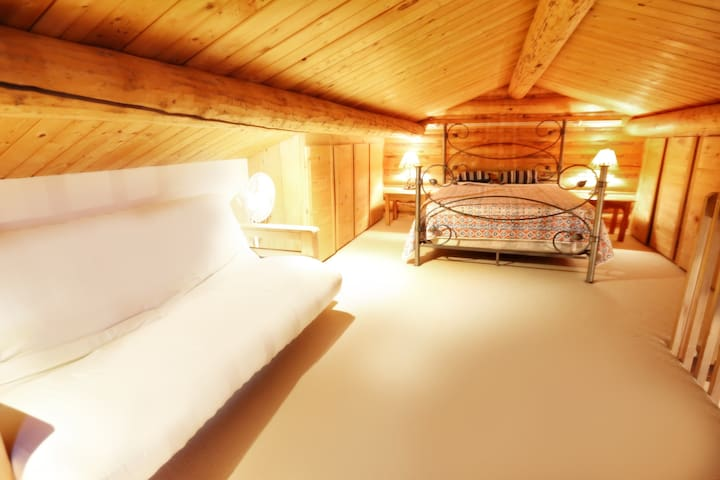 The loft provides queen bed and a futon.