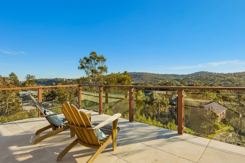 Relaxed sun drenched deck overlooking Avalon Beach