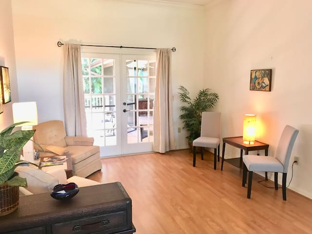 A comfortable living room greets you upon entry. Patio doors provide easy access to the lanai.