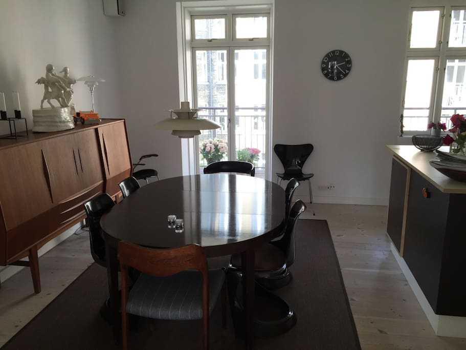 Dining room with access to balcony.