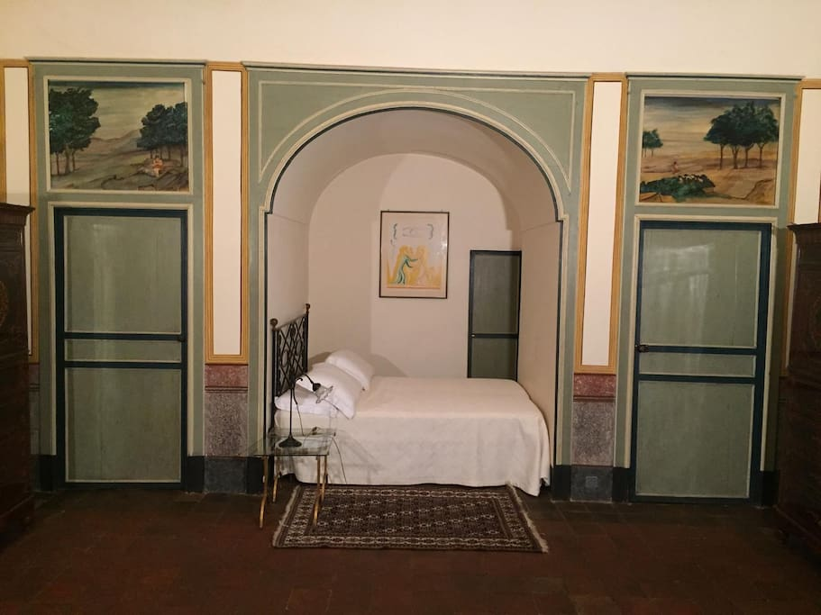 the alcove. Right door leads to the bathroom, left door leads to the small sleeping room