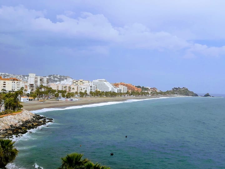 Bright seafront apartment with superb sea views.