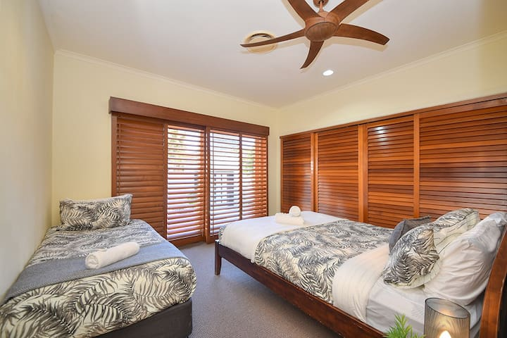 Queen + Single Bedroom with A/C, ceiling fan and large robe. This bedroom has direct sliding door access to the front courtyard.