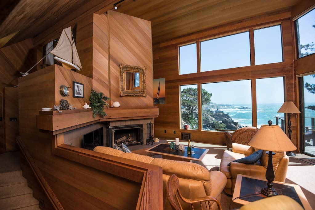 """Living room with soaring ceilings, forever views, wood burning fireplace, 50"""" smart TV and game table."""