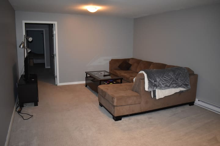 Living room with super comfortable sectional and flat screen tv