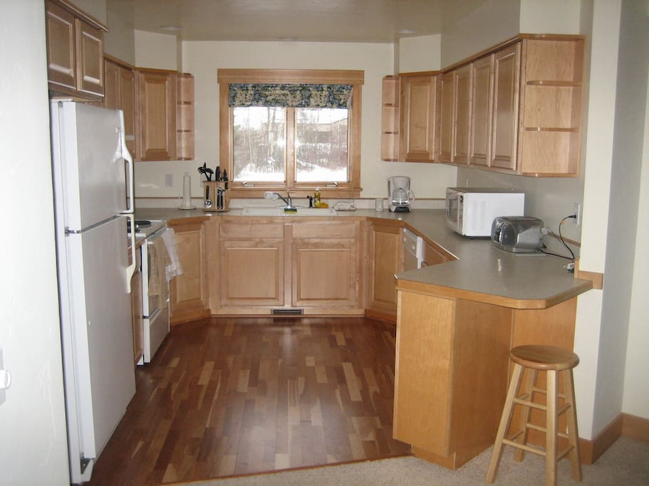 Full kitchen with all appliances and cooking utensils.